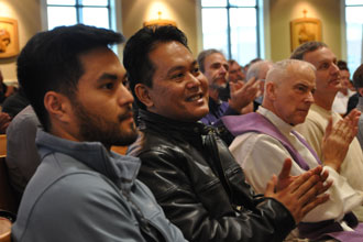 Mark Oropilla, left, and Joe Oropilla, parishioners of St. James Church in Elizabethtown, Ky., listened to Archbishop Joseph E. Kurtz during the Catholic Men's Conference March 5. (Record Photo by Jessica Able)