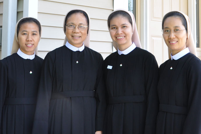 Sister Maria Nguyen Thi Thao Trinh, Sister Raphael Vu Thi Tiet Minh, Sister Maria Hoang Ngoc Tuong Vi and Sister Teresa Ha Thi Thuy Trang, from left, are pictured at their convent on East Francis Avenue, about a 1/2 mile from St. John Vianney Church. The Vietnamese sisters — members of the Congregation of the Servants of Jesus, the High Priest — will minister at St. John Vianney in a variety of roles, including religious education. (Record Photo by Jessica Able)