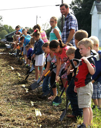 Children from St. Vincent de Paul Church in New Hope, Ky., hold shovels during a ground-breaking ceremony at the Nelson County parish last month. A new multipurpose parish center will be constructed to accommodate the needs of the parish. (Photo Special to The Record)