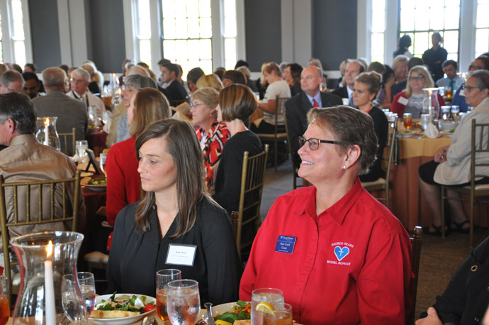 Amy Fears, left, a teacher at Sacred Heart Model School, and Ann Carol Grant, assistant principal of Sacred Heart Model School, listened to Archbishop Joseph E. Kurtz at last week's luncheon recognizing Catholic school educators. (Record Photo by Jessica Able)