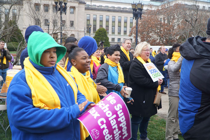 Students of Nativity Academy, left, Richard A. Lechleiter, president of the Catholic Education Foundation, and Carol Nord, executive director of Nativity Academy, cheer at the Kentucky School Choice Rally Jan. 27.