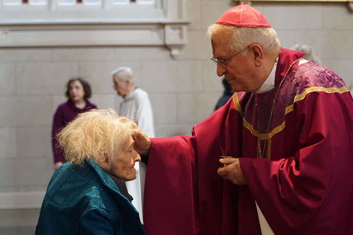 Archbishop Joseph E. Kurtz placed ashes on the forehead of Martha Dawson during a Mass at the Cathedral of the Assumption in downtown Louisville March 1.