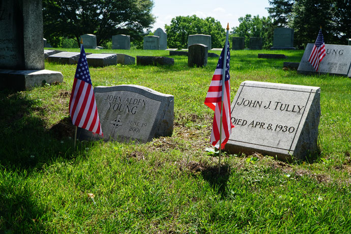 Flags decorate graves at Calvary Cemetery, 1600 Newburg Road, on Memorial Day, May 29.