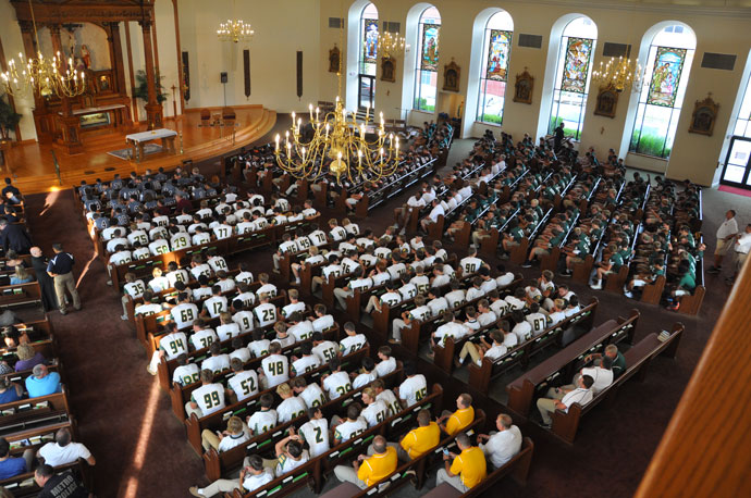 More than 600 football players from DeSales, Holy Cross, St. Xavier and Trinity high schools and Our Lady of Providence High School in Clarksville, Ind., attended the rosary rally sponsored by SportsLeader July 26.