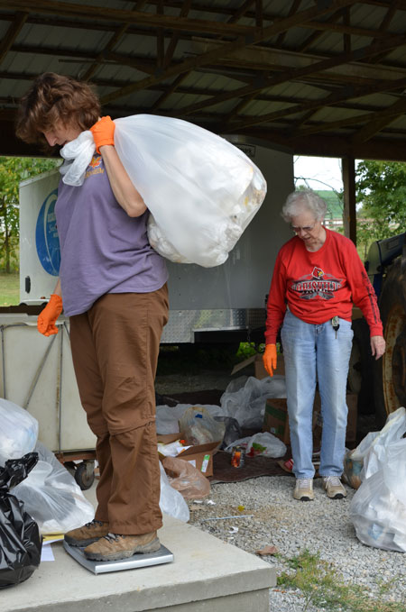 "Carolyn Cromer, left, director of ecological sustainability for the Sisters of Charity of Nazareth, and Sister Rosemarie Kirwan weighed trash during a waste audit conducted by the Sisters of Charity of Nazareth recently. The SCNs participated in a ""Caring for Creation"" presentation Sept. 12 at St. Francis of Assisi Church. (Photo Special to The Record)"