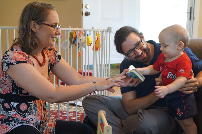 Kate Bulinski and Ned Berghausen played with their one-year-old son E.J. in their Highlands home Aug. 18. The couple is finding ways to balance their young family, careers and formation to the diaconate. (Record Photo by Ruby Thomas)