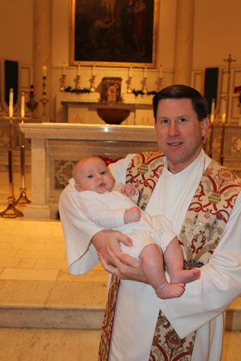 Bishop-elect J. Mark Spalding held his nephew Brady Spalding in 2013 following his baptism. Bishop-elect Spalding has baptized all of his nieces and nephews and presided at their first Communions. (Photo Special to The Record)