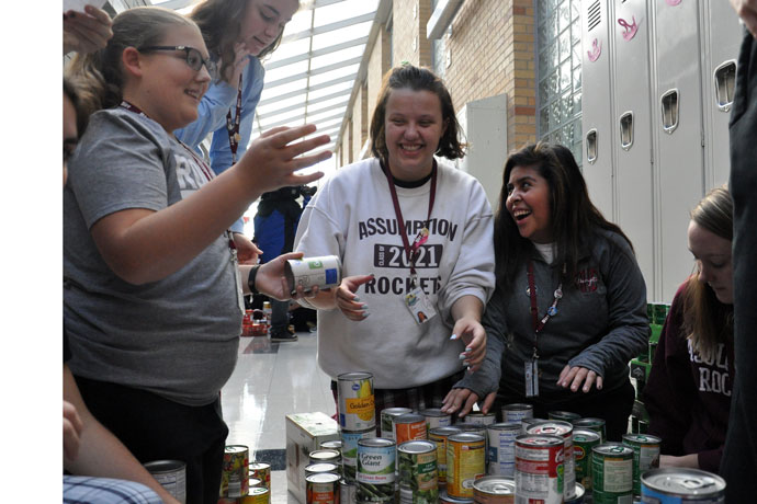 Assumption High School students built three dimensional shapes using thousands of canned goods.  (Photo Special to The Record)