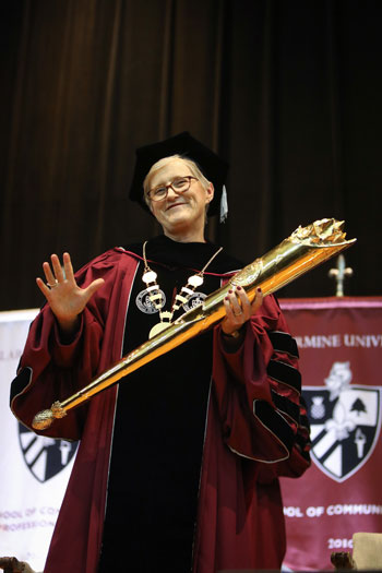Dr. Susan M. Donovan was inaugurated as Bellarmine University's fourth president Oct. 27. Here, she is shown with the university mace, which represents the office and authority of the president. (Special to The Record by Jessica Ebelhar)