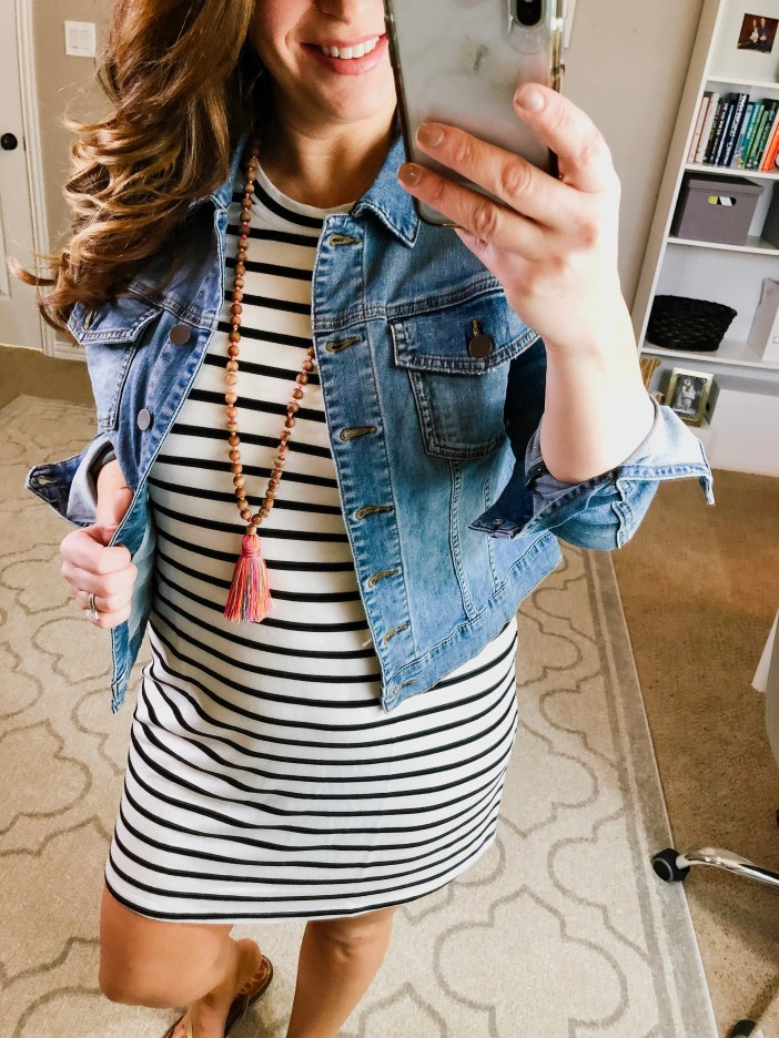 Summer outfit with light denim jacket, tassel necklace and stripe jersey dress. Perfect casual mom attire!