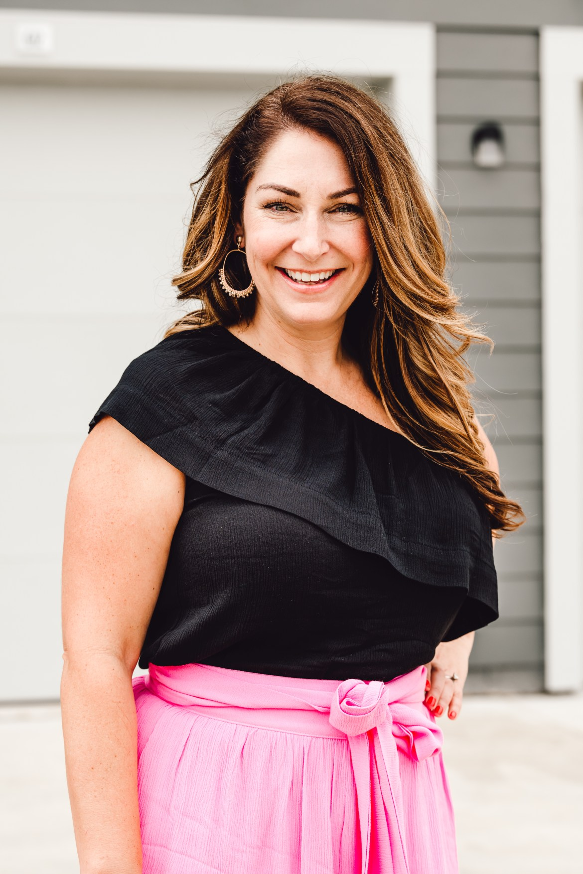 black one shoulder top with pink skirt great for summer
