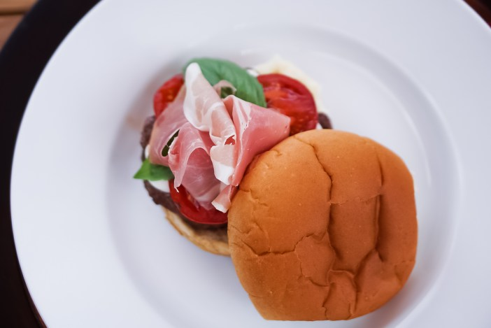 Italian Burger-1/4 lb beef patty Tomatoes sliced and marinaded in a high quality Balsamic Vinegar Fresh Mozzarella sliced and slightly melted on the patty Basil 1 slice of Prosciutto Bun of choice