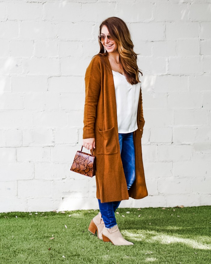 Long duster cardigan in rust with snake print crossbody mini bag