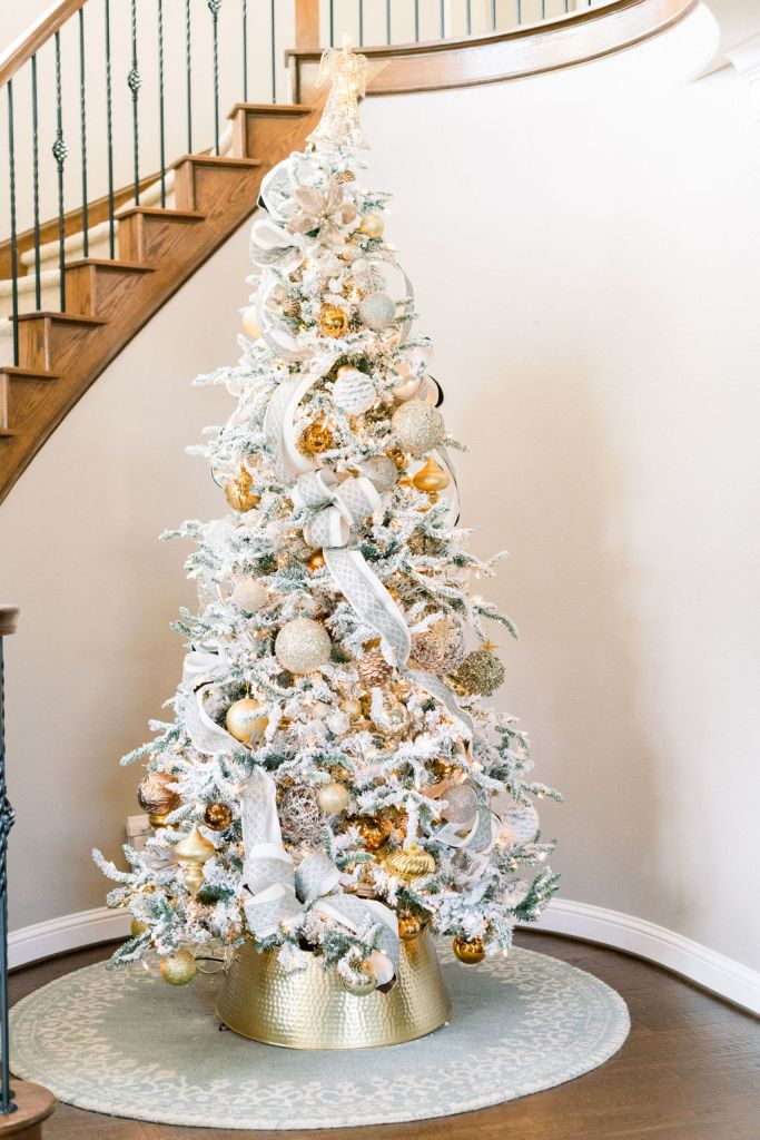 Amazon 9 ft pre-lit tree with flocking and gold and silver ornaments #christmastree #silverandgold #flockedtree