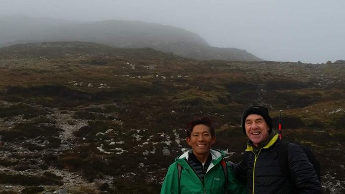 "Mingma Tsiri and Michael Cusack, author of ""Croagh Patrick and the Islands of Clew Bay"" on the shoulder of Croagh Patrick"