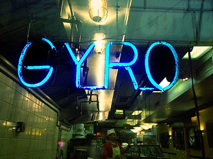 gyro sign in a window
