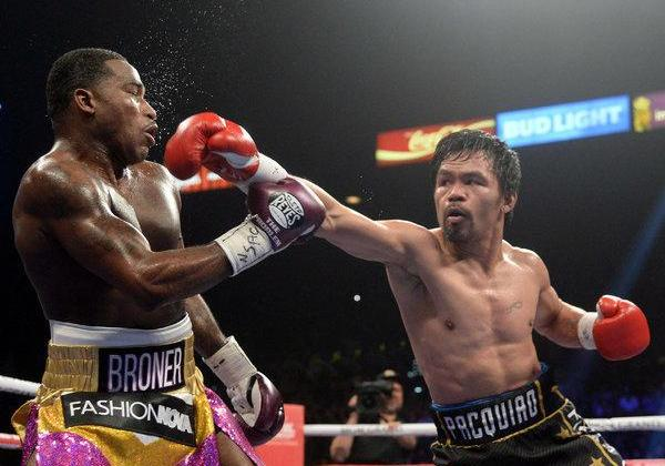 Manny Pacquiao challenges Floyd Mayweather for a rematch after beating Adrien Broner