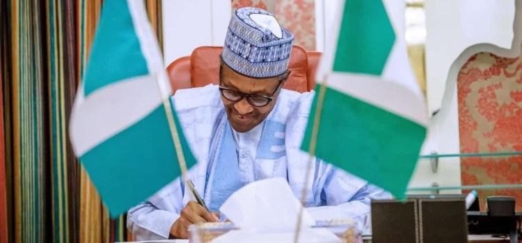 Breaking News! Buhari signs N30,000 Minimum Wage Bill into law