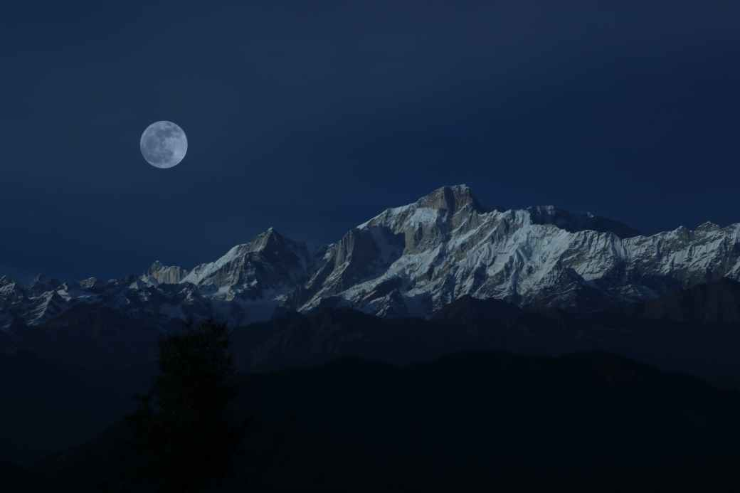 mountain peak under full moon