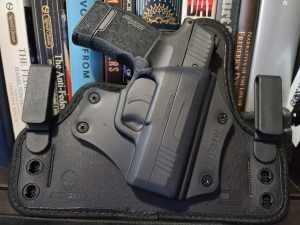 A holstered Sig Sauer P365