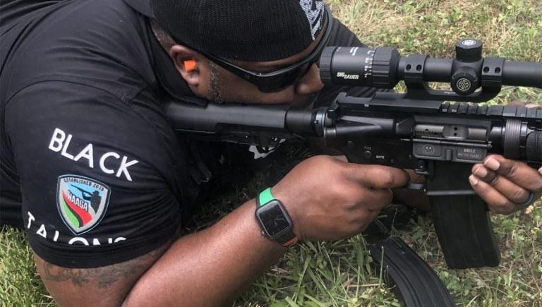 An NAAGA member shoots an AR-15