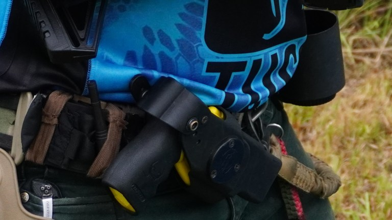 A shooter wears a taser at a competition