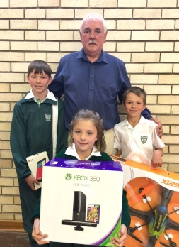 Laerskool Hangklip principal Jannie Pretorius with the pupils who sold the most tickets for the school's lucky draw, from left, JJ Fouche, Phillipa van Deventer and Rynard de Beer. The main prize of a boat trip was won by Danny Mulder