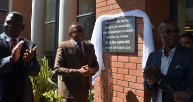CAREER EXPO: Deputy Minister of Higher Education and Training Mduduzi Manana unveils the plaque at the Ikhala TVET College building on behalf of Minister Blade Nzimande, with, from left, Ikhala TVET College principal Ntozelizwe Tom with, right, chairman of the TVET council Bonga Zuma Picture: ABONGILE SOLUNDWANA