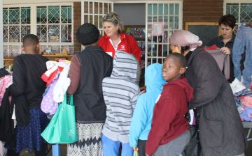 STREET STORE: Mandy de Villiers and Alicia Els from Balmoral Pre-Primary School help residents choose items of clothing during the school's Street Store event on Saturday.   Picture: BHONGO JACOB