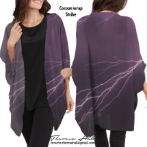 Wrap that covers the top half of the body. Sleeves go down to halfway down forearm just below the elbow. Colour is in purple hues with flashes of lightning across from right to left. The pattern is on the front and back sides of the garment.