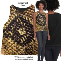 A sleeveless top with an image of part of a skin of a cobra on the front. The tone in beige, cream and black colours. The back of the garment is black.