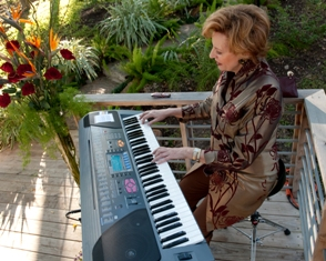 Theresa playing keyboard outside