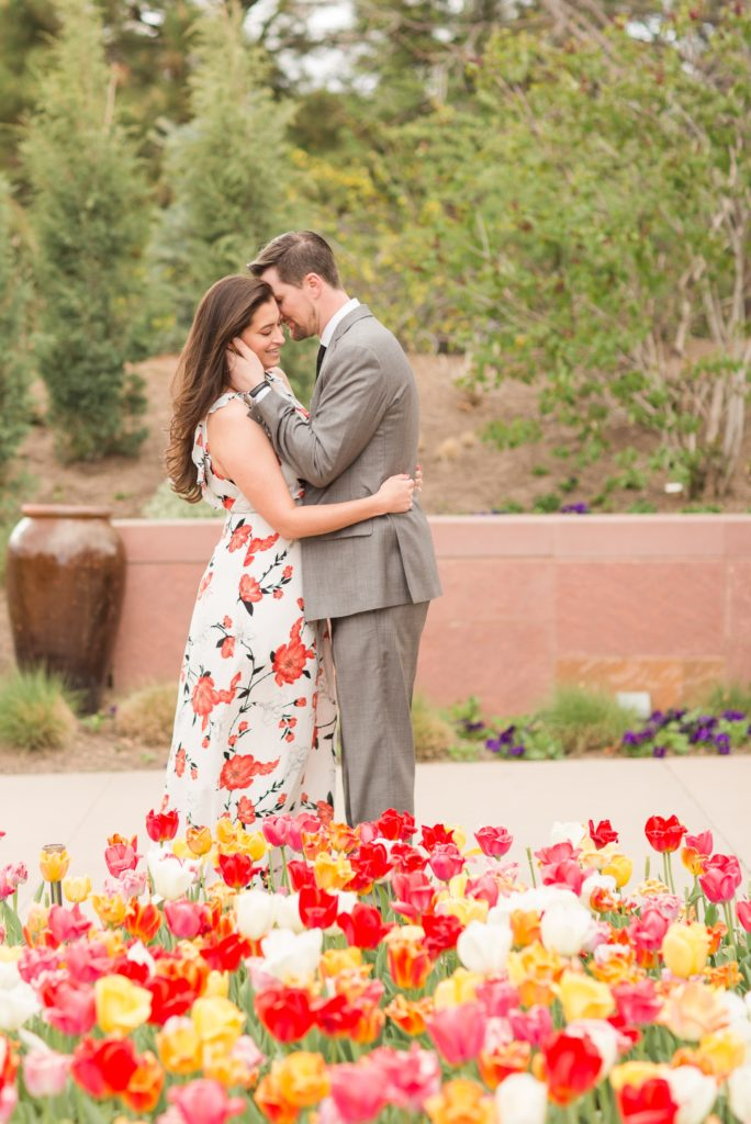 Engagement session in a tulip field at Denver Botanical Garden. Colorado wedding photographer