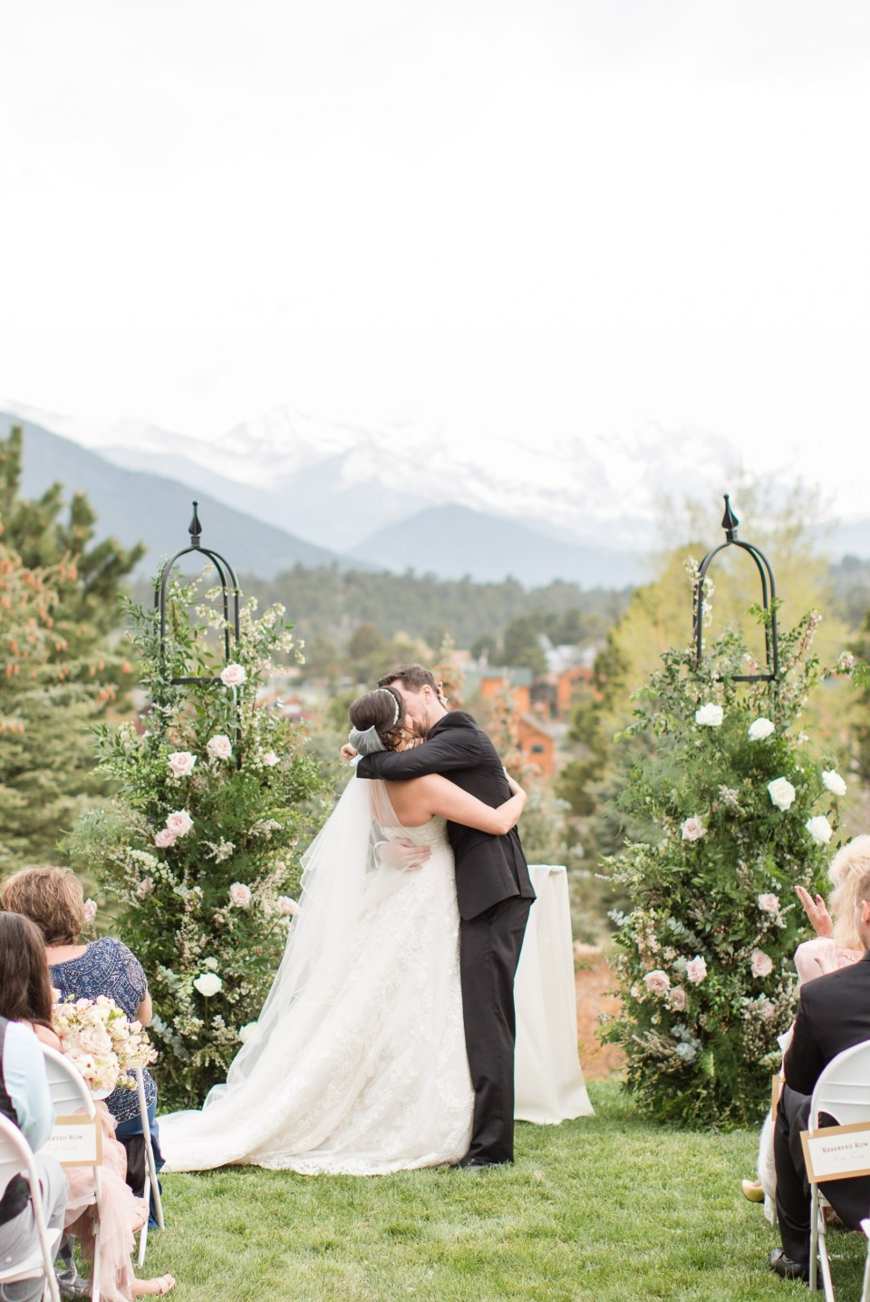 Couple sharing their first kiss on the longs peak long at the Stanley Hotel in Estes Park Colorado.