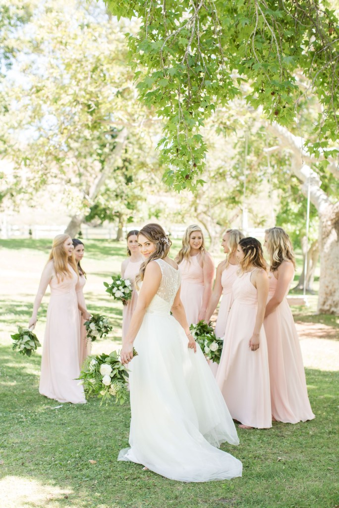 Bride posing with bridesmaids at Coto Valley Country Club.