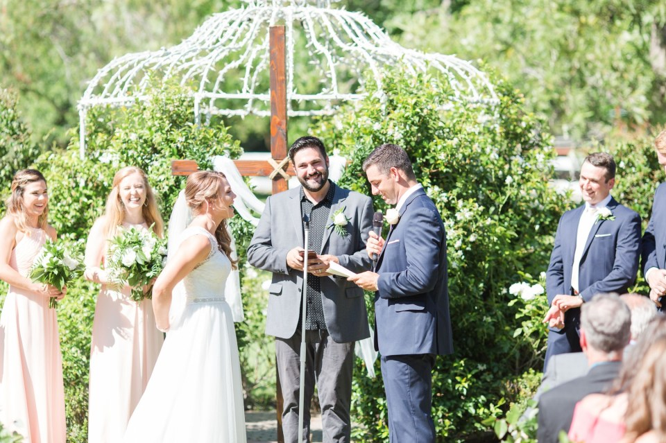 Bride and groom exchanging vows at Coto Valley Country Club in Coto De Caza California.