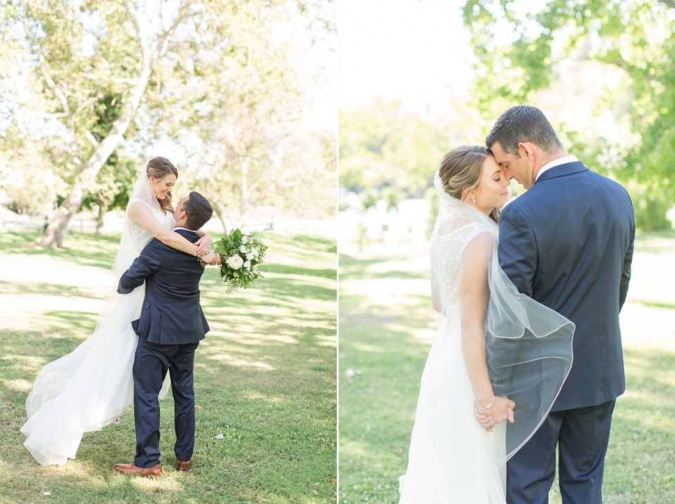 Groom softly kissing his brides for-head while holding her tight on wedding day.