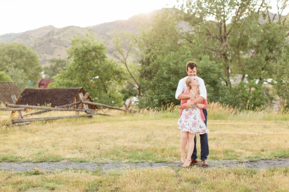 Groom giving his fiance a bear hug at Golden history park in Golden Colorado.