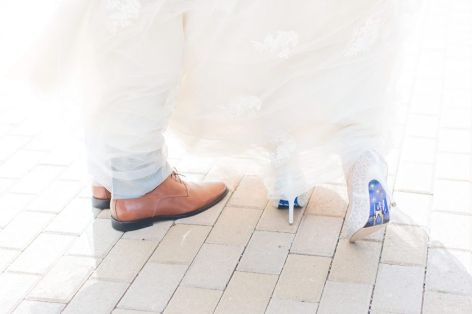 Bride in custom painted wedding shoes.