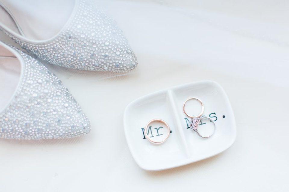 Wedding rings inside a Mr. and Mrs. ring holder.