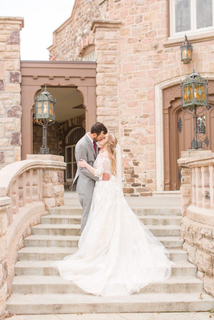 Bride and groom posing in front of the Highlands Ranch Mansion venue in Colorado.