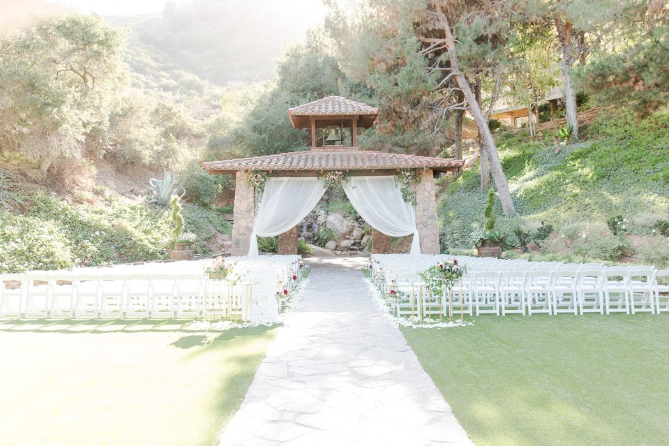 Pala Mesa Resort ceremony site with chic fall decor. Colorado wedding photographer Theresa Bridget Photography