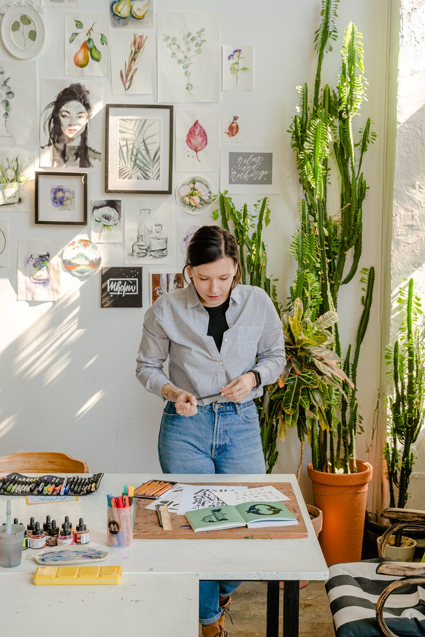 photo of woman looking at her works