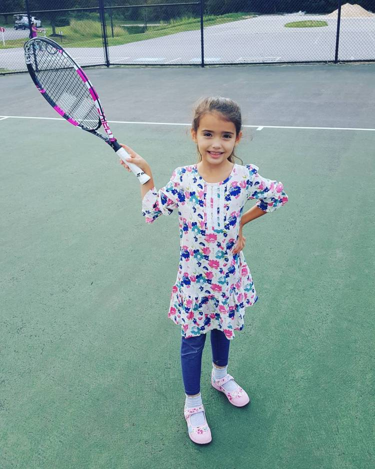 We left the house thinking church was at 9 instead of 10... just enough time to get in a quick practice with her new @babolat racket.