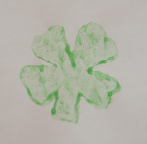 Your child will enjoy watching you create the 4 leaf clover potato stamp.