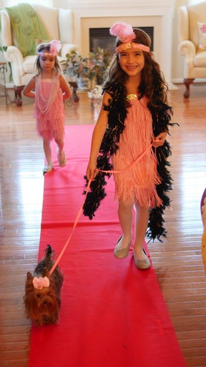 Theresa's Reviews - Kid-Friendly Oscar Party Ideas - With a red carpet to walk down, children will love showing off their glamorous clothes. 5 Must Try Tips For The Ultimate Kid-Friendly Oscar Party - Movie Themed Party - Movie Party - Hollywood Party