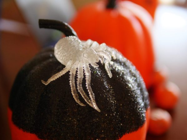 To make your house spooktacular, having lots of little decorations helps. Find some spiders and pumpkins in the dollar section to make your home festive. Theresa's Reviews 2017 Halloween Decor