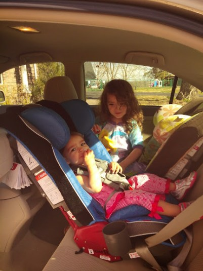 Keep your child rear facing until age 2. They will learn to adjust to the space and get comfortable.