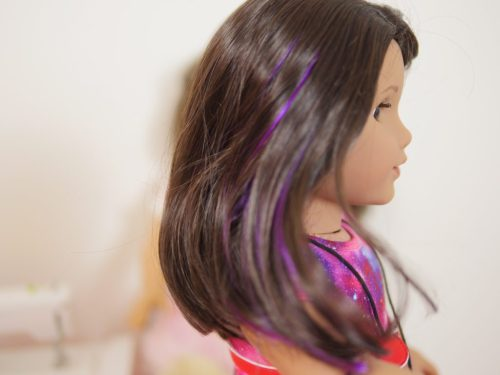 Luciana Vega has a purple streak in her hair.