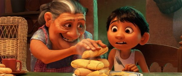 "MORE TAMALES -- In Disney•Pixar's ""Coco,"" Abuelita—Miguel's loving grandmother—runs the Rivera household like Mamá Imelda did two generations before her. Their philosophy is simple: Work in the family shoemaking business, eat more tamales and, most importantly, ""No music!"" Featuring the voices of Renée Victor as Abuelita and Anthony Gonzalez as Miguel, Disney•Pixar's ""Coco"" opens in U.S. theaters on Nov. 22, 2017. ©2017 Disney•Pixar. All Rights Reserved."